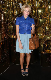 Pixie Lott broke up her blue palette with a camel-colored leather tote by Mulberry.