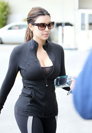 Kim Kardashian headed to the gym wearing a chic pair of Dolce & Gabbana cateye sunnies.