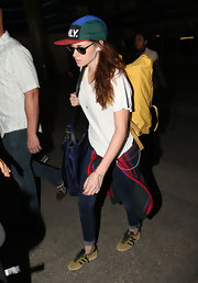Kristen Stewart traveled with a bright yellow backpack by Fjallraven.