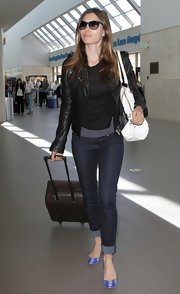 Jessica Biel was edgy-casual in Genetic Denim skinnies and a studded leather jacket while catching a flight at LAX.