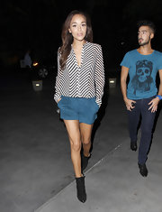 Ashley Madekwe teamed her blouse with blue faux-suede shorts, also by Armani Exchange.