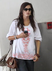 Camilla Belle kept a low profile in a pair of tortoiseshell cateye sunnies while making her way through LAX.