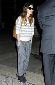Rachel Bilson completed her laid-back travel getup with a pair of baggy gray slacks.