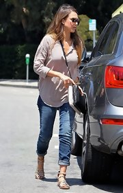 Jessica Alba completed her laid-back look with nude gladiator sandals by Koolaburra.