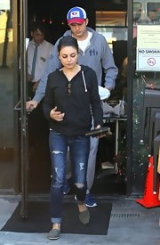 Mila Kunis teamed her top with a pair of ripped jeans by American Eagle Outfitters.
