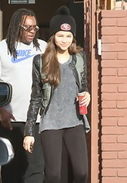 Zendaya Coleman topped off her look with a black pompom beanie.