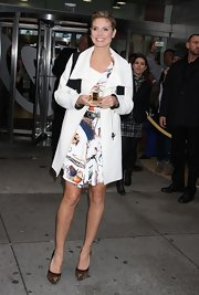 Heidi Klum was chic while out promoting her fragrance, Shine, in a black and white coat paired with fierce platform pumps.