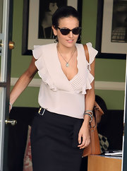 Camilla Belle stepped out of the nail salon wearing retro tortoiseshell shades by Ralph Lauren.