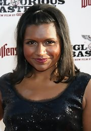 Mindy Kaling looked retro-chic wearing this teased half updo at the LA premiere of 'Inglourious Basterds.'