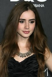 Lily Collins styled her LBD with a crystal collar necklace for the D&G flagship boutique opening.
