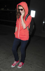 Wearing a pink hoodie and a pair of skinny jeans, Anna Kendrick looked just like a teenager as she arrived on a flight in New York.