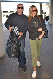 Jennifer Aniston was dressed down and comfy in white Superga sneakers, army pants, and a blazer while catching a flight out of LAX.