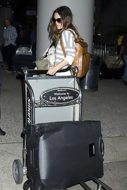 Rachel Bilson arrived on a flight at LAX carrying a stylish camel-colored leather backpack.