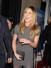 Jennifer Aniston paired a silver clutch with a gray mini dress for the New York screening of 'Management.'