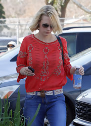 January Jones paired a printed belt with a red peasant blouse for a day out in LA.