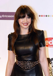 Daisy Lowe's oversized studded belt and leather dress were an edgy-glam pairing!