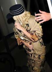 Lady Gaga covered up with a striped cap and a trenchcoat for a flight out of LAX.