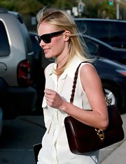 Kate Bosworth styled a basic sleeveless blouse with a chic brown shoulder bag while out in Beverly Hills.