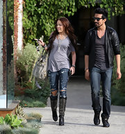 Miley Cyrus teamed a loose gray Obesity + Speed T-shirt with distressed jeans for a day out in LA.