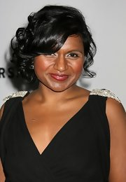 Mindy Kaling styled her hair into a glamorous curly updo for the NBC Golden Globes after-party.