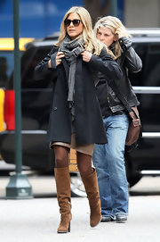 Jennifer Aniston headed to the set of 'Wanderlust' looking cozy in tan Ferragamo boots and a black trenchcoat.