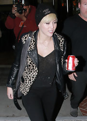 Miley Cyrus finished off her look with a black knit beanie by Chanel.