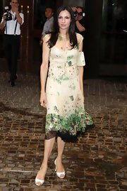 Famke Janssen complemented her easy breezy look with a pair of white peep-toes at a movie screening.