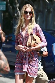Rosie Huntington-Whiteley was spotted out in Hollywood looking effortlessly chic in this crocodile clutch and print dress combo.