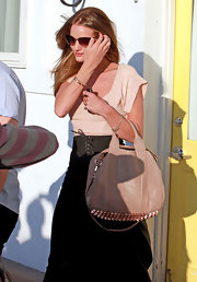 Rosie Huntington-Whiteley carried an edgy-chic Alexander Wang Rocco stud-bottom bag while visiting the salon.