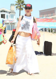 Gwen Stefani contrasted her edgy top with a girly white peasant skirt.