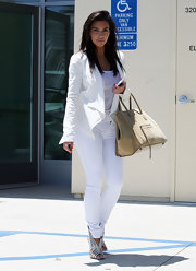 Kim Kardashian punched up her monochromatic look with a pair of Balenciaga statement booties.