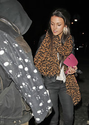 Michelle Keegan styled her outfit with a leopard-print scarf for a night out in Manchester.