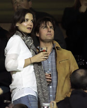Katie Holmes watched a soccer match in Sevilla, Spain wearing a patterned gray scarf and white shirt combo.