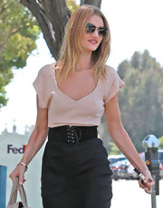 Rosie Huntington-Whiteley accentuated her tiny waist with an oversized black lace-up belt while visiting the salon.