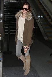 Emma Watson took a flight to LAX looking tough-chic in a brown Ralph Lauren utility jacket with a faux-fur collar.