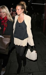 Sienna Miller teamed her suit with a white chain-strap bag by Chloe.