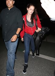 Kristen Stewart dressed down in a red hoodie and blue jeans for a flight out of LAX.