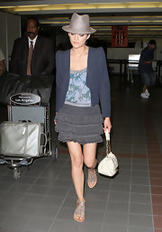 Marion Cotillard teamed her mini with a blue cropped jacket for a dressier look.