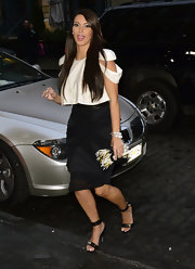 Kim Kardashian styled her outfit with a Christian Louboutin Sweet Charity Woodoo calf-hair bag.