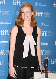 Jessica Chastain kept it youthful and cute in a black-and-white sleeveless top by Marc Jacobs during the 'Coriolanus' press conference.