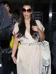 Kim Kardashian landed at LAX wearing a pair of oversized sunglasses by Tom Ford.