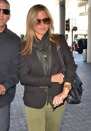 Jennifer Aniston styled her airport outfit with an ombre scarf by Allsaints.