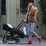 Sienna Miller chose gray jeans, a fur coat, and studded red boots for a day out with her baby.