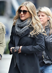 Jennifer Aniston bundled up in a gray knit scarf and a black trenchcoat on the set of 'Wanderlust.'