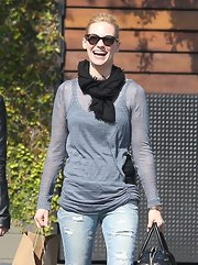 January Jones paired a black scarf with a sheer gray top for a lunch out.
