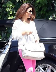Eva Longoria arrived at Chateau Marmont carrying a white leather tote by Coach.
