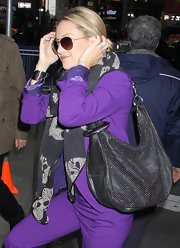 Kate Hudson accessorized with a studded black hobo bag by Jimmy Choo for her visit to 'Good Morning America.'
