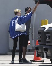Miley Cyrus paired her jacket with black skinny jeans.