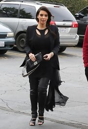 Kim Kardashian teamed Christian Louboutin slashed booties with an all-black outfit for a rocker-chic look.