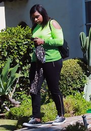 Mindy Kaling cut a bright figure in a long-sleeve neon-green tee with sleeve cutouts while out in LA.